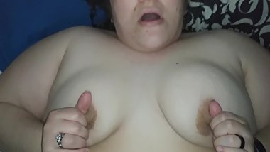 Playing with my big tits and squirting on his dick