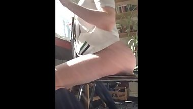 Teen rides dildo til orgasm on chair facing window