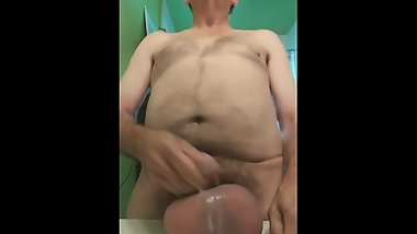 Watch Barrycase jack his cock and cum all over his balls.