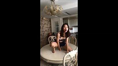 Chinese girl masturbates on family dinner table
