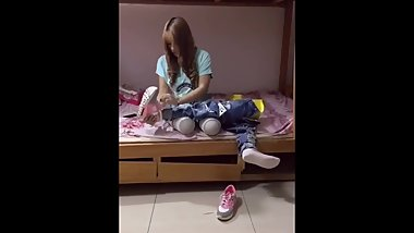 Chinese DAK amputee girl putting on her legs