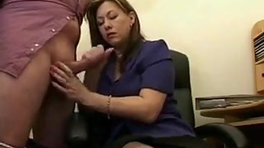 Mature Handjob In The Office