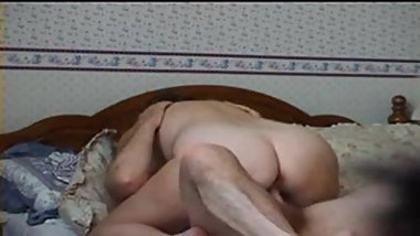 Husband and wife on bed