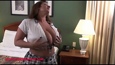 Big Bosoms pornstar dressed in a very short skirt