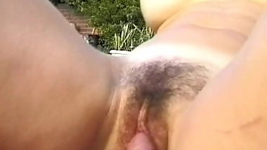 Hairy mature gets a thick dick by the poolside