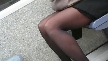 Candid working woman in black tights pantyhose in the tube