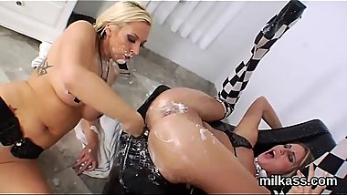 Frisky lesbos fill up their massive asses with cream and ejaculate it out