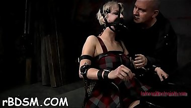 Blindfolded and gagged beauty gets her bawdy cleft shovelled with toy